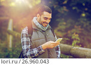 happy man with backpack and smartphone outdoors. Стоковое фото, фотограф Syda Productions / Фотобанк Лори