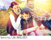 Купить «happy family with tablet pc and tent at camp site», фото № 26960051, снято 27 сентября 2015 г. (c) Syda Productions / Фотобанк Лори