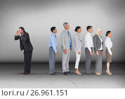 Купить «Businessman calling in opposite direction of group», фото № 26961151, снято 26 сентября 2018 г. (c) Wavebreak Media / Фотобанк Лори