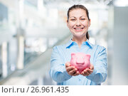 Купить «Happy woman holds a piggy bank full of money, photo in office», фото № 26961435, снято 6 августа 2017 г. (c) Константин Лабунский / Фотобанк Лори