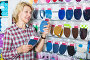 Woman next to shelf with textile patches, фото № 26961739, снято 20 сентября 2017 г. (c) Яков Филимонов / Фотобанк Лори