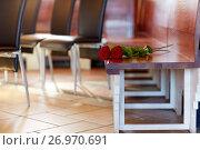 Купить «red roses on bench at funeral in church», фото № 26970691, снято 20 марта 2017 г. (c) Syda Productions / Фотобанк Лори