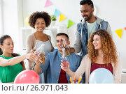 Купить «happy team with drinks celebrating at office party», фото № 26971043, снято 3 сентября 2017 г. (c) Syda Productions / Фотобанк Лори