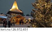 Купить «Evening scene of Santa Claus Village in Rovaniemi, Finland», видеоролик № 26972651, снято 6 января 2017 г. (c) Данил Руденко / Фотобанк Лори