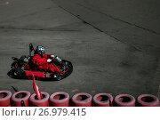 Купить «Вид сверху на соревнования по картингу на картодроме в Москве, Россия», фото № 26979415, снято 22 сентября 2017 г. (c) Николай Винокуров / Фотобанк Лори