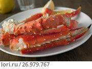 Купить «Red king crab legs», фото № 26979767, снято 3 января 2014 г. (c) Stockphoto / Фотобанк Лори