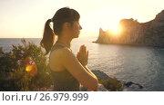 Купить «Meditation of young woman at sunset», видеоролик № 26979999, снято 19 сентября 2017 г. (c) Илья Шаматура / Фотобанк Лори
