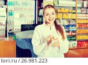 Купить «Smiling pleasant young female pharmacist posing», фото № 26981223, снято 18 июля 2018 г. (c) Яков Филимонов / Фотобанк Лори
