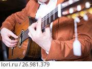 Купить «Male musician performing on guitar», фото № 26981379, снято 29 марта 2017 г. (c) Яков Филимонов / Фотобанк Лори