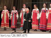 Купить «Мальчик в одежде казака поёт на сцене в Раменском», эксклюзивное фото № 26981671, снято 5 апреля 2017 г. (c) Дмитрий Неумоин / Фотобанк Лори