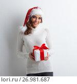 Купить «Woman with Christmas gift», фото № 26981687, снято 27 ноября 2016 г. (c) Иван Михайлов / Фотобанк Лори