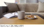 Купить «chocolate oatmeal cookies and mug with hot drink», видеоролик № 26982091, снято 20 сентября 2017 г. (c) Syda Productions / Фотобанк Лори