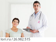 Купить «Doctor man with breast cancer awareness ribbon and patient», фото № 26982515, снято 17 января 2019 г. (c) Wavebreak Media / Фотобанк Лори