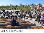 Купить «Moscow, Russia - September 23. 2017. people rest in amphitheater in park Zaryadye.», фото № 26983051, снято 23 сентября 2017 г. (c) Володина Ольга / Фотобанк Лори
