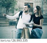 Купить «Energetic man and woman traveling with map and baggage», фото № 26993335, снято 25 мая 2017 г. (c) Яков Филимонов / Фотобанк Лори