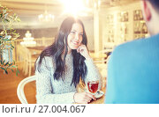 Купить «happy couple drinking tea at cafe», фото № 27004067, снято 23 января 2016 г. (c) Syda Productions / Фотобанк Лори