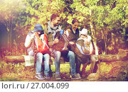 Купить «happy family with backpacks and thermos at camp», фото № 27004099, снято 27 сентября 2015 г. (c) Syda Productions / Фотобанк Лори