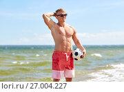 Купить «young man with soccer ball on beach», фото № 27004227, снято 27 июля 2017 г. (c) Syda Productions / Фотобанк Лори