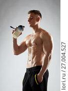 Купить «young man or bodybuilder with protein shake bottle», фото № 27004527, снято 2 июля 2017 г. (c) Syda Productions / Фотобанк Лори