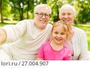 Купить «senior grandparents and granddaughter selfie», фото № 27004907, снято 9 августа 2017 г. (c) Syda Productions / Фотобанк Лори