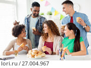 Купить «happy friends or team eating at office party», фото № 27004967, снято 3 сентября 2017 г. (c) Syda Productions / Фотобанк Лори