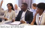 Купить «happy business team at international conference», видеоролик № 27010027, снято 22 января 2020 г. (c) Syda Productions / Фотобанк Лори