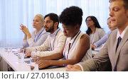 Купить «happy business team at international conference», видеоролик № 27010043, снято 22 января 2020 г. (c) Syda Productions / Фотобанк Лори