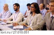 Купить «happy business team at international conference», видеоролик № 27010051, снято 22 января 2020 г. (c) Syda Productions / Фотобанк Лори