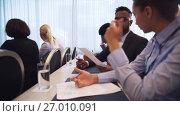 Купить «happy business team at international conference», видеоролик № 27010091, снято 27 февраля 2020 г. (c) Syda Productions / Фотобанк Лори