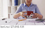 Купить «female architect with house model and blueprint», видеоролик № 27010131, снято 7 сентября 2017 г. (c) Syda Productions / Фотобанк Лори