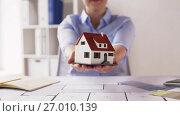 Купить «female architect with house model and blueprint», видеоролик № 27010139, снято 7 сентября 2017 г. (c) Syda Productions / Фотобанк Лори