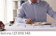 Купить «male architect with ruler measuring blueprint», видеоролик № 27010143, снято 7 сентября 2017 г. (c) Syda Productions / Фотобанк Лори