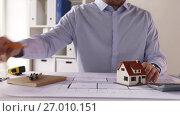 Купить «architect with house model and blueprint», видеоролик № 27010151, снято 11 сентября 2017 г. (c) Syda Productions / Фотобанк Лори