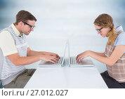 Купить «Nerd couple at laptops against blurry blue wood panel», фото № 27012027, снято 16 сентября 2019 г. (c) Wavebreak Media / Фотобанк Лори