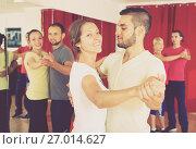 Купить «Romantic couple dancing in dancing school», фото № 27014627, снято 17 февраля 2020 г. (c) Яков Филимонов / Фотобанк Лори