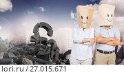 Купить «Broken concrete stone with pound money symbol and people with bag heads smiley faces in cityscape», фото № 27015671, снято 19 августа 2018 г. (c) Wavebreak Media / Фотобанк Лори