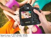 Composite image of cropped hand of photographer holding camera. Стоковое фото, агентство Wavebreak Media / Фотобанк Лори