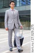 Купить «Businessman carrying suitcase», фото № 27029275, снято 8 мая 2017 г. (c) Яков Филимонов / Фотобанк Лори