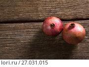 Купить «Pomegranates on a wooden table», фото № 27031015, снято 12 июня 2017 г. (c) Wavebreak Media / Фотобанк Лори