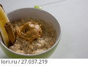 Купить «Cup of oats with peanut butter and cinnamon sticks», фото № 27037219, снято 13 июня 2017 г. (c) Wavebreak Media / Фотобанк Лори