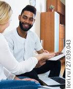 Купить «Interracial couple discussing banking offer for mortgage at home», фото № 27039043, снято 18 сентября 2019 г. (c) Яков Филимонов / Фотобанк Лори