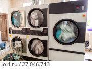 Купить «Automatic laundry ironing line», фото № 27046743, снято 14 сентября 2017 г. (c) Евгений Ткачёв / Фотобанк Лори