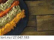 Купить «Various type of spice powder on slate plate», фото № 27047183, снято 5 июня 2017 г. (c) Wavebreak Media / Фотобанк Лори