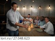 Купить «Man opening champagne bottle», фото № 27048623, снято 28 мая 2017 г. (c) Wavebreak Media / Фотобанк Лори
