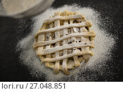Купить «Cropped image of strainer over pie», фото № 27048851, снято 5 мая 2017 г. (c) Wavebreak Media / Фотобанк Лори