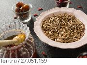 Bowl of cereal bran stick, yogurt, honey and dried fruits. Стоковое фото, агентство Wavebreak Media / Фотобанк Лори