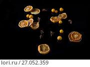 Купить «Sweet lemon and cape gooseberry on black background», фото № 27052359, снято 12 июня 2017 г. (c) Wavebreak Media / Фотобанк Лори