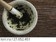Купить «Herb paste in mortar and pestle on wooden table», фото № 27052451, снято 5 июня 2017 г. (c) Wavebreak Media / Фотобанк Лори