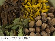 Купить «Nutmeg, bay leaf, cinnamon stick and turmeric», фото № 27053067, снято 5 июня 2017 г. (c) Wavebreak Media / Фотобанк Лори