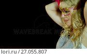 Купить «Woman wearing masquerade mask on stage 4k», видеоролик № 27055807, снято 6 июня 2020 г. (c) Wavebreak Media / Фотобанк Лори